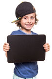 Kid holding a chalkboarb Royalty Free Stock Image