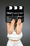 Kid holding clapper board. Cinema concept Royalty Free Stock Photos