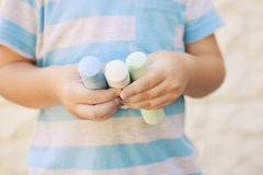 Chalk paints. Kid holding colored chalk paints for drawing Royalty Free Stock Image