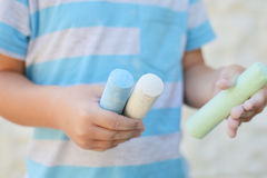 Chalk paints. Kid holding colored chalk paints for drawing Royalty Free Stock Photo