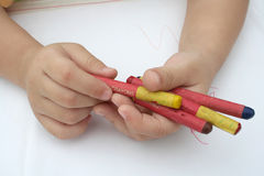Kid holding crayon. Kid's hand holding crayon royalty free stock image