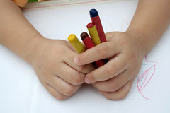 Kid holding crayon. Kid's hand holding crayon Stock Image