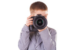 Kid holding a dslr camera isolated on the white Royalty Free Stock Photography