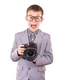 Kid holding a dslr camera isolated on the white Stock Photo