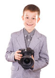 Kid holding a dslr camera isolated on the white Stock Photos