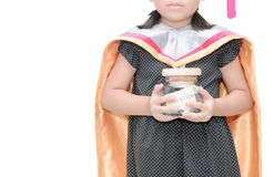 Kid holding education money savings in a glass jar Royalty Free Stock Photo