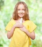 Kid holding an energy saving lamp Stock Photos