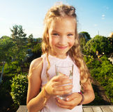 Kid holding glass with water Royalty Free Stock Photo