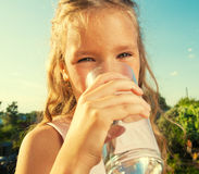 Kid holding glass with water Stock Photo