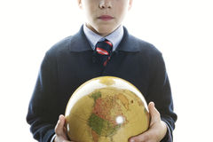 Kid holding globe in his hand. Stock Image