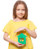 Kid holding a green house Royalty Free Stock Photography