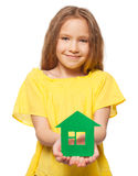Kid holding a green house Royalty Free Stock Image
