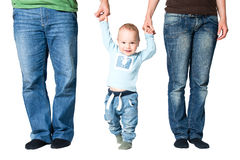 Kid holding hands of parents Stock Images
