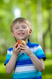 Kid holding healthy food apple outdoor Stock Image