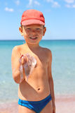 Kid is holding a jellyfish on the  beach Stock Photos