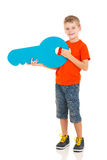 Kid holding key Stock Image