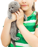 Kid holding a kitten Stock Images