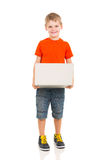 Kid holding laptop Stock Images