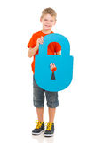 Kid holding lock. Handsome kid holding blue paper lock royalty free stock photography