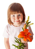 Kid holding orange lily. Cheerful kid holding orange lily isolated on white stock images