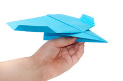 Kid holding paper origami airplane Royalty Free Stock Photo