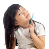 Kid holding pencil Stock Images