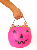 Kid holding a pink plastic pumpkin Stock Photo
