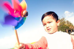Kid holding Pinwheel. Royalty Free Stock Photo