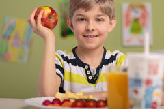 Kid holding red apple Royalty Free Stock Image