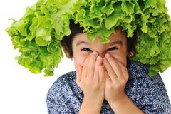 Kid holding salad hat Stock Photos