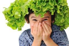 Kid holding salad hat Stock Photos