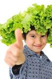Kid holding salad hat Stock Photo