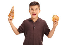 Kid holding a sandwich and a slice of pizza. Cheerful kid holding a sandwich in one hand and a slice of pizza in the other isolated on white background Stock Image