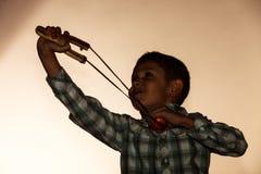 Kid holding slingshot in hands Royalty Free Stock Image