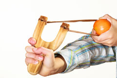 Kid holding slingshot in hands Stock Photo