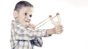 Kid holding slingshot in hands Royalty Free Stock Photo