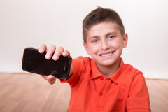 Kid holding smartphone Stock Photo