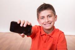 Kid holding smartphone stock photo