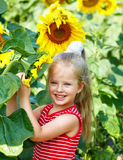 Kid holding sunflower outdoor. Stock Photography