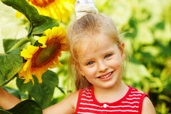 Kid holding sunflower outdoor. Royalty Free Stock Images
