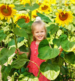 Kid holding sunflower outdoor. Royalty Free Stock Photo
