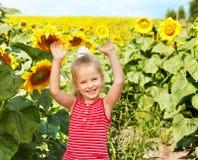 Kid holding sunflower outdoor. Stock Photo