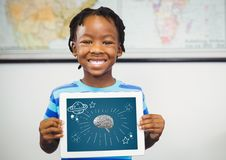 Kid holding tablet grey brain and white space doodles against dark blue background. Digital composite of Kid holding tablet grey brain and white space doodles stock photography