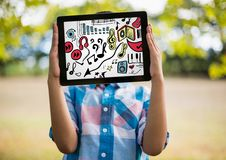 Kid holding tablet over face showing music doodles and white background Royalty Free Stock Image