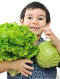 Kid holding vegetables Stock Images