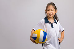 Kid Holding Volleyball, Isolated on White. Kid holding volleyball, studio shot, isolated on white stock photo