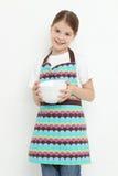 Kid holding white bowls Royalty Free Stock Image