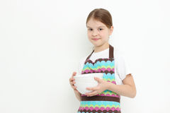 Kid holding white bowls Royalty Free Stock Photo