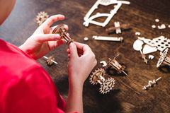 Kid holding wooden gear toy Royalty Free Stock Photo