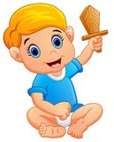 Kid holding a wooden knife Stock Photography